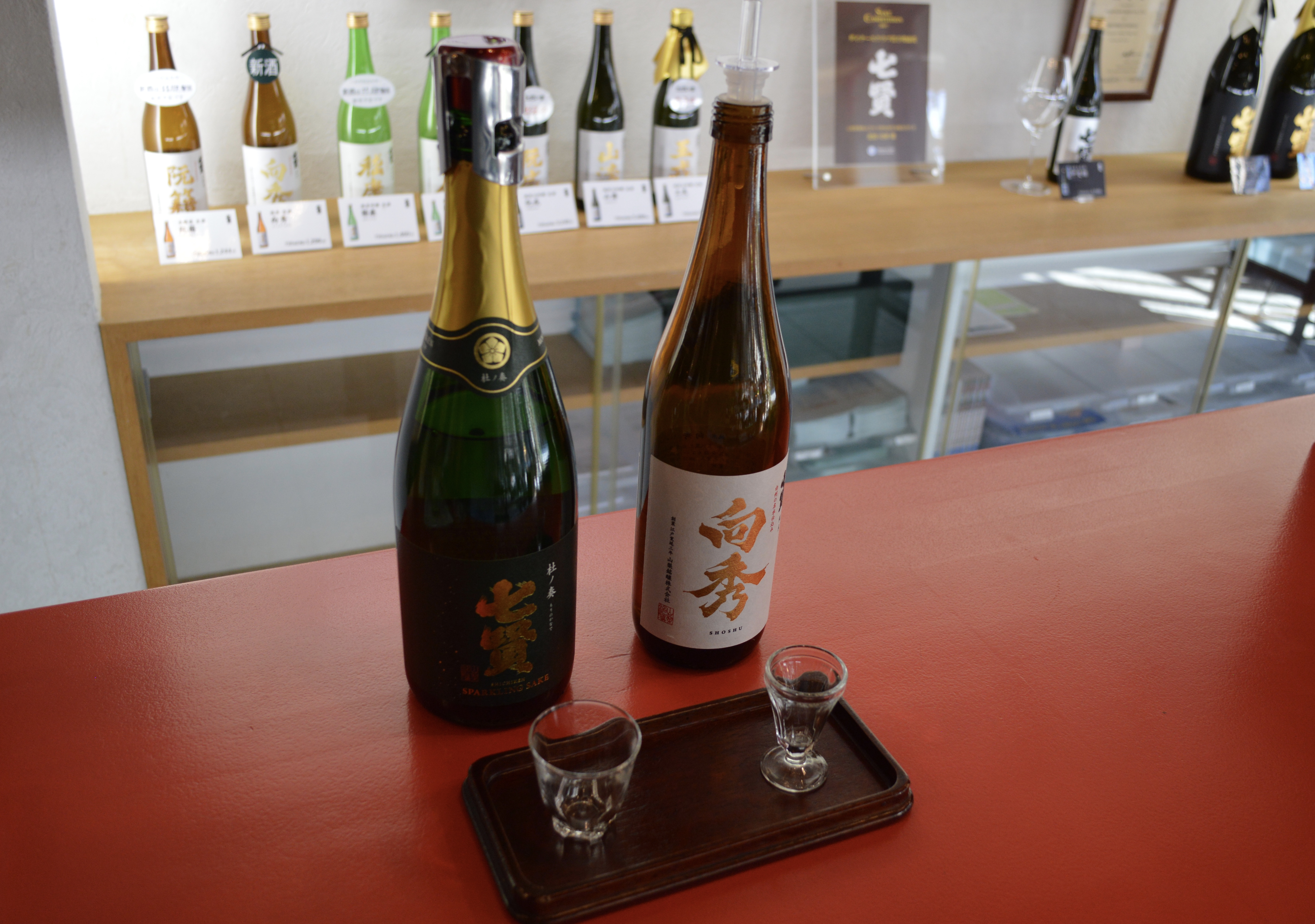 Ryogo Kitahara has also developed a sparkling sake that has its initial fermentation in oak barrels (left).