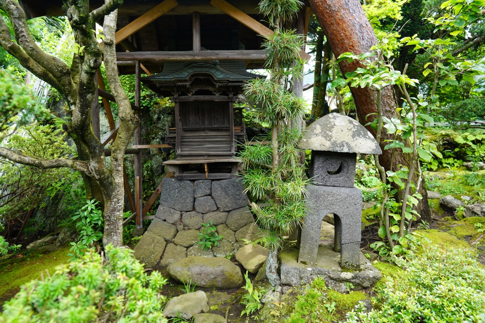 The miniature shrine, whose base is made of volcanic stones, is part of Ide Jyozoten's 300-year-old garden.