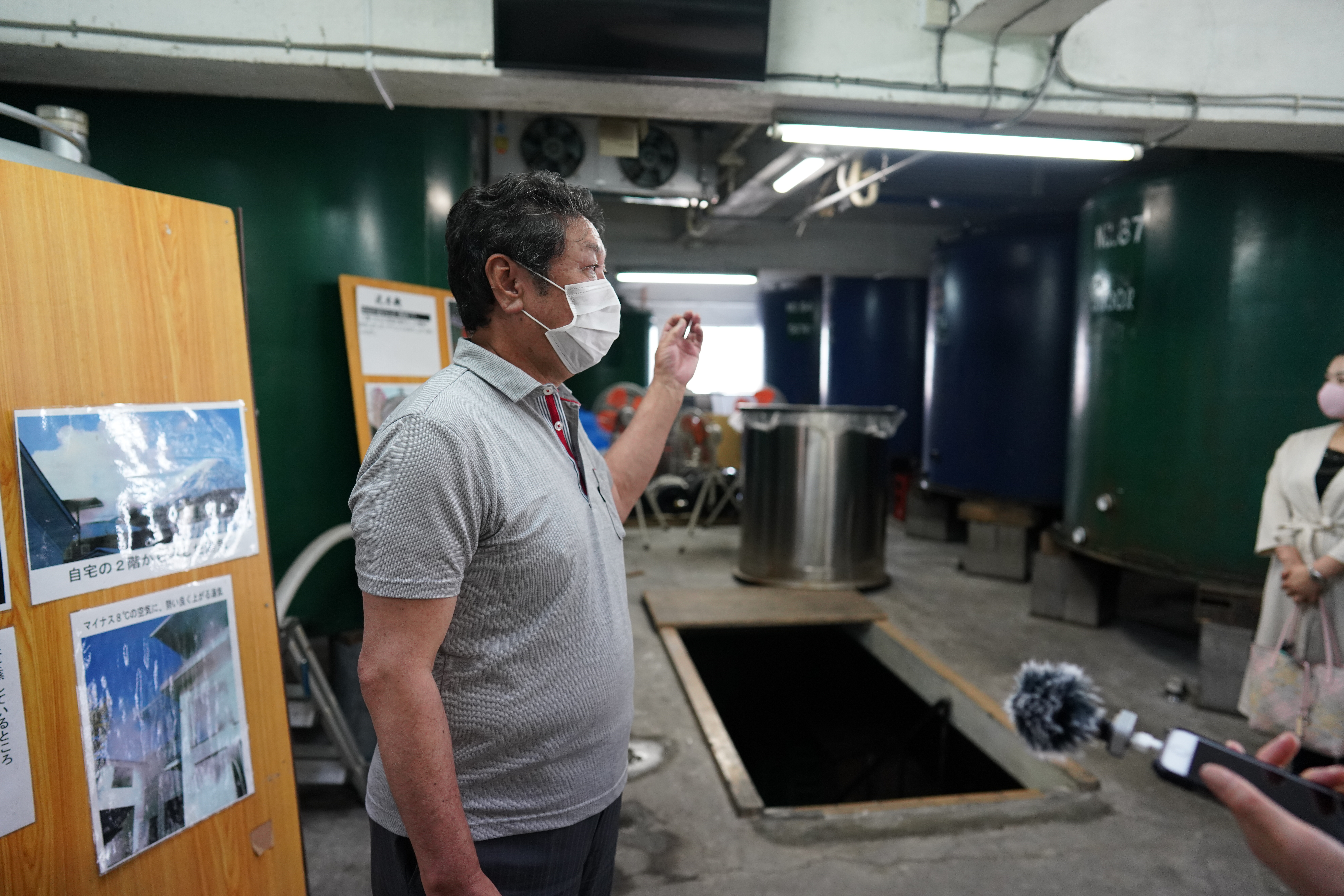 This photo of the sake brewery's owner, Mr. Ide, is a testament to Japan's strict adherence to COVID-19 protocol.